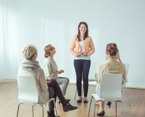 women in rehab group therapy