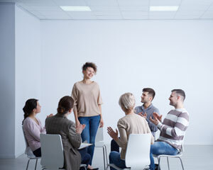 clients smiling in group therapy