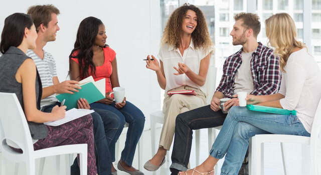 patients laughing in group therapy